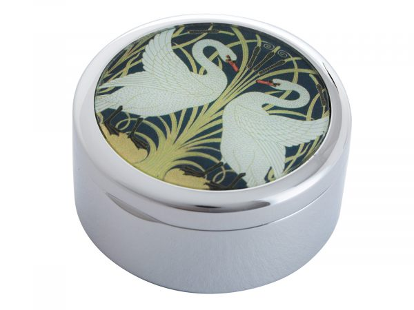 """This beautifully crafted Pillbox by John Beswick comes with a stunning extract from Walter Crane's """"Two Swans"""".Walter Crane was an English artist and book illustrator. He is considered to be the most influential, and among the most prolific, children's book creators of his generation. Size: Diameter: 5 cm - 2"""" By John Beswick Product Code: P10CRA(S)"""