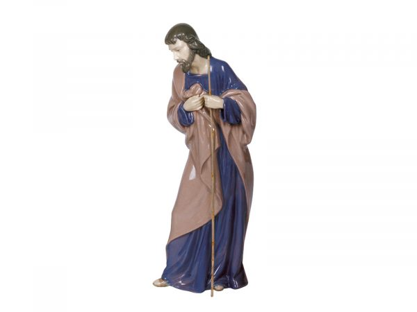 A beautiful porcelain sculpture of Saint Joseph, wearing a brown coat and holding a staff, this Nao figurine would be a beautiful addition to any Nativity set this Christmas.