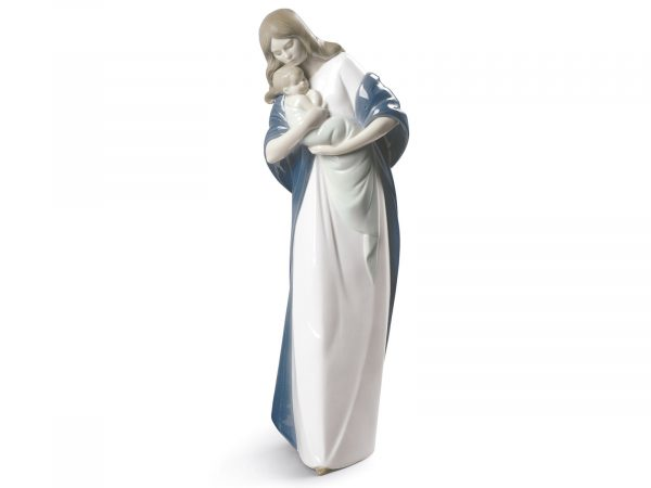 Madonna, which translated from Italian ma donna, meaning 'my lady' is a beautiful representation of Mary. In a long pure white dress wrapped in a blue overcoat she hugs her baby Jesus. Size: 35 x 12 cm By Nao Product Code: 02001560