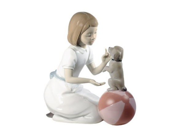 Nao porcelain figurine of a young girl teaching her puppy tricks