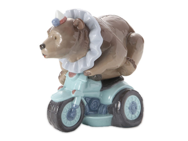Lladro figurine of a bear riding a motorcycle