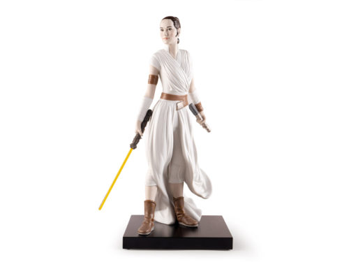 Lladro figurine of Star Wars Rey posing with a lightsaber
